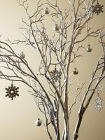 Silver branch centerpieces give a winter-season wedding a touch of sparkle.