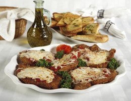 Golden breaded cutlets form the base for luscious chicken parmigiana.