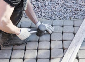 An overhead view of a masonry worker using a mallot.