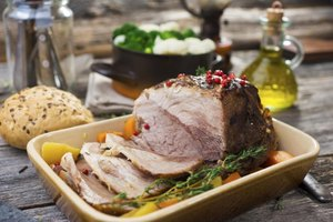 Serve porketta with smashed potatoes and fresh vegetables.