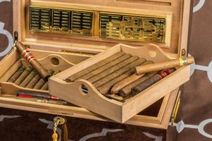 A humidor and a large box of cigars.