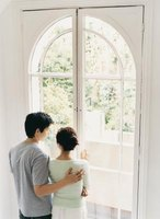 Beautiful arched windows are a challenge to cover.