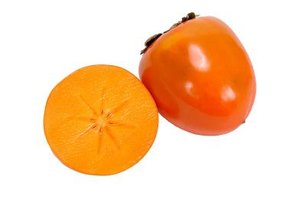 Asian persimmons are spectacular in early winter when their bright-orange fruit hang on bare branches.