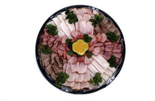 Cut and roll deli meat into flowers for a garden-themed meat tray.
