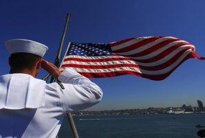 Sailor in the Navy saluting the U.S. flag.