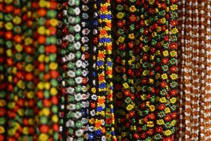 Huichol jewelry uses fine seed beads to create intricate patterns.