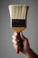 Choose a high-quality brush that will not shed hairs as you work or a foam brush.