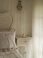 Re-purpose old wainscoting or barn wood for a shabby chic-style nightstand.