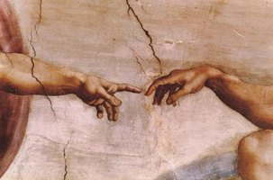 God Creates Man: Detail of The Sistine Chapel by Michelangelo Buonarroti, 1512.