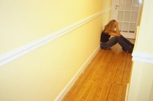 Run floorboards in rows down angled halls, creating angles at the ends of the hall for easy placement.