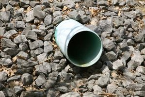 A French drain contains underground pipes surrounded by gravel.