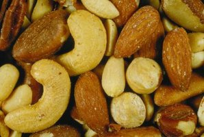 Avoid sharing bowls of mixed nuts that include varieties toxic to dogs.