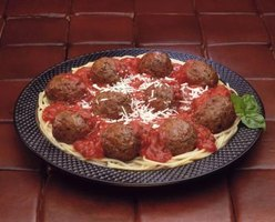 Drain the grease from meatballs before adding them to a dish.