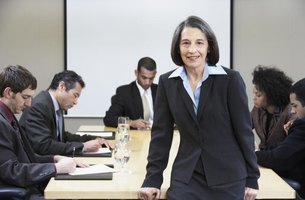 Smiling businesswoman leading business meeting.