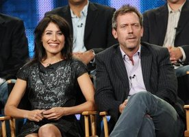 "Hugh Laurie shows his signature ""House"" look on a press tour with Lisa Edelstein."
