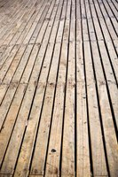 Deck boards can be fastened to joists by multiple methods.