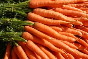 Carrots and other root vegetables can be diced, blanched and frozen for long storage.