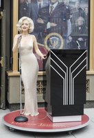 Monroe's wax figure at Madame Tussauds wears a copy of her skintight presidential birthday gown.