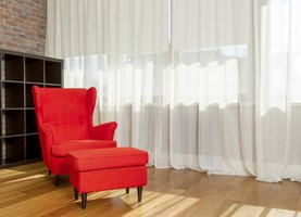 Floor-to-ceiling curtains offer visual softness, warmth and the idea of larger windows.