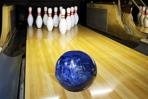 Oil used on the bowling lanes collects in the pores of the ball.
