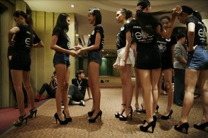 Candidates line up for an Elite model competition in Thailand.