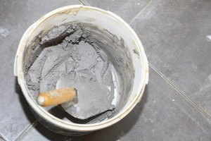 Bucket of wet cement.