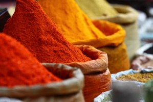 In India, curry spices are piled high at outdoor markets.