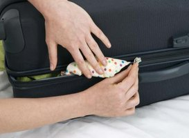 Candle wax and olive oil can be used to lubricate your suitcase zipper.