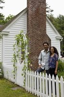 A picket fence with an arbor creates separation while encouraging foot traffic.