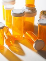 For variety, make a few pill bottle toys with different items inside.