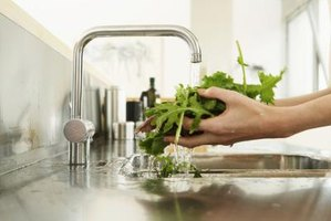 Many modern kitchen faucets have a water saver feature that restricts the water flow.