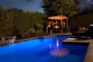 Adding lights to the pool helps create a safe environment for nighttime swimming.