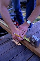Use a tape measure to square a deck frame.