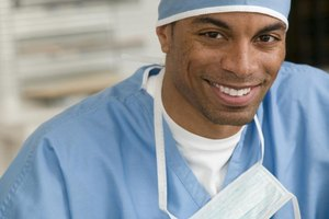 Smiling surgeon in operating clothes.