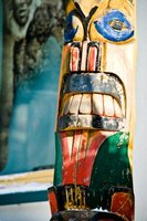 Use recycled materials to make mini totem poles.