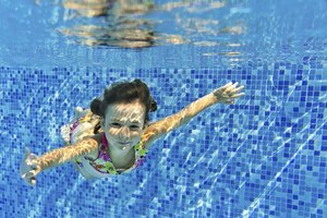 Swimming underwater is one of the easiest ways for a child to move through the water.