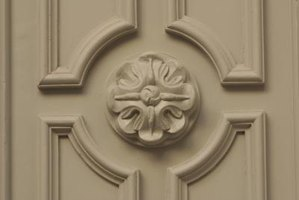 Apply ready-made moldings to dress up plain doors.