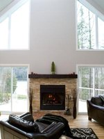 A floating mantel typically resembles a single shelf mounted on the wall above the fireplace.