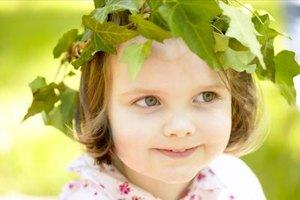 Once a laurel wreath is placed on a child's head, she is transformed into a Greek goddess.
