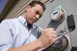 A meter reader collects kilowatt usage information from an electrical meter.