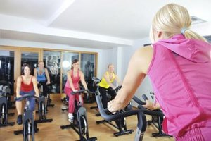 Instructor teaching a spinning class.