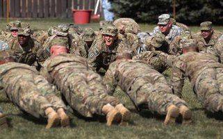 Army soldiers perform pushups, a daily-dozen exercise.