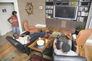 Men watching television in living room.