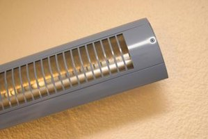 A wall-mounted electric heater is a viable option for a basement apartment.
