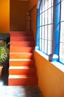 Stucco walls, bright paint and tiled or paved floors typify Mexican style.