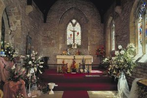 Use large floral arrangmenets to decorate a church altar.