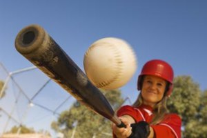 Keep your form steady to make solid contact in softball.
