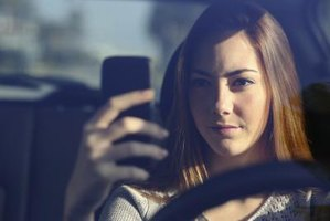 Teen driver typing on her phone