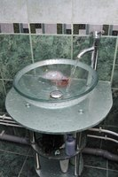 Vinegar removes water spots and greasy residue on a glass sink.