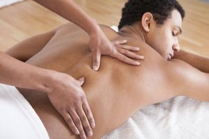 A personal trainer receives a massage.